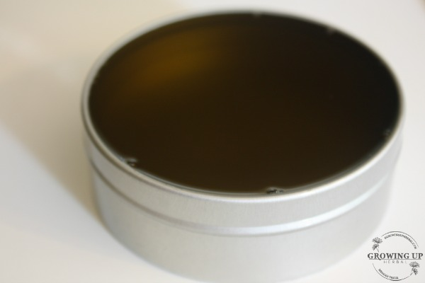 """Homemade Herbal """"Neosporin"""" Coconut Oil Salve   GrowingUpHerbal.com   A DIY """"Neosporin"""" like salve for all your kids cuts, scratches, and scrapes!"""
