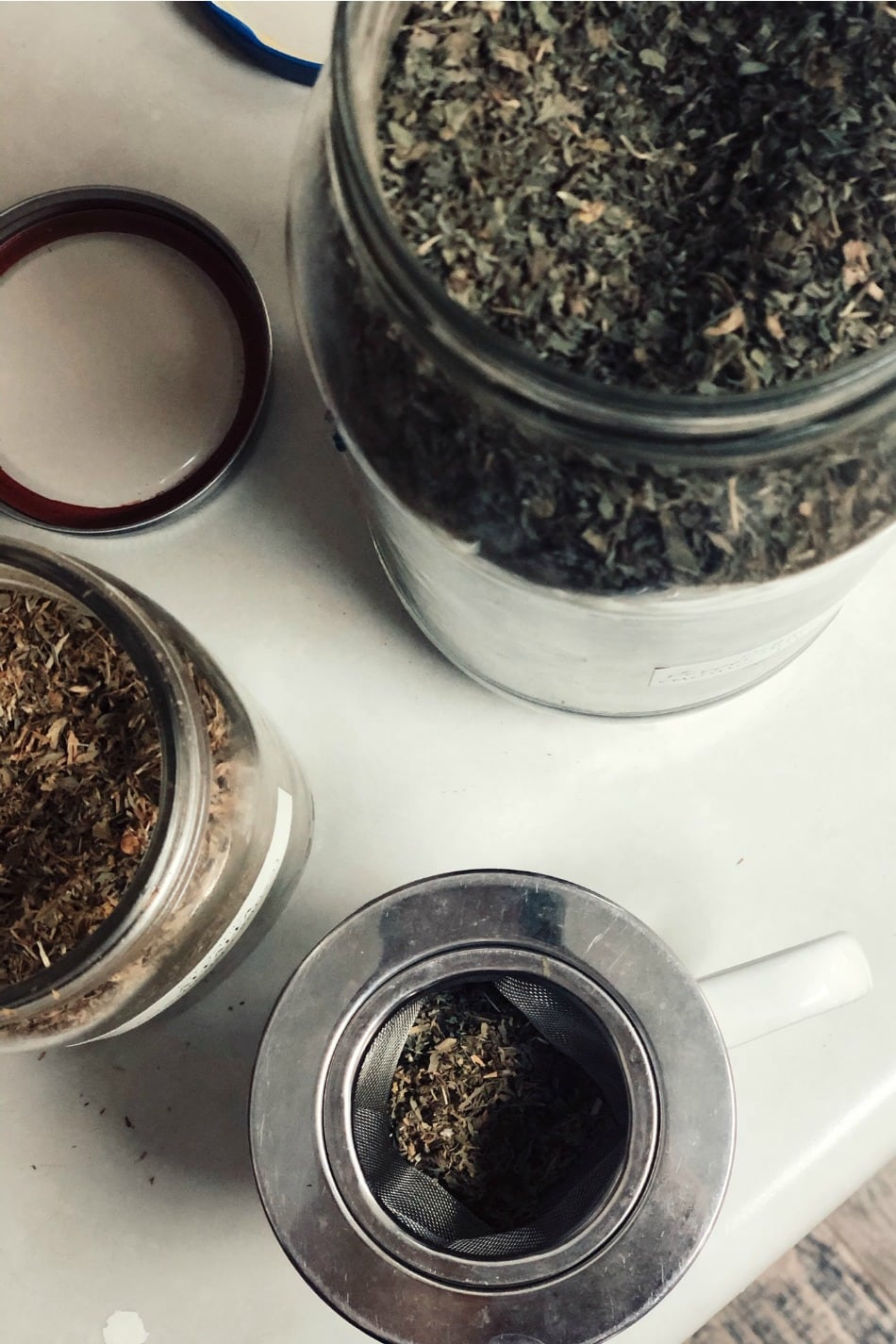 dried herbs in jars, making tea