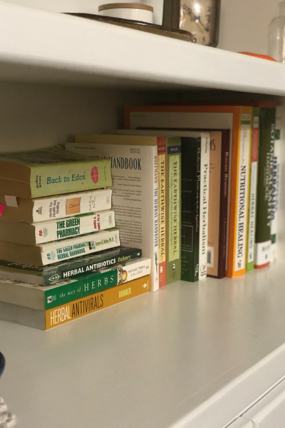 bookshelf with herbal books