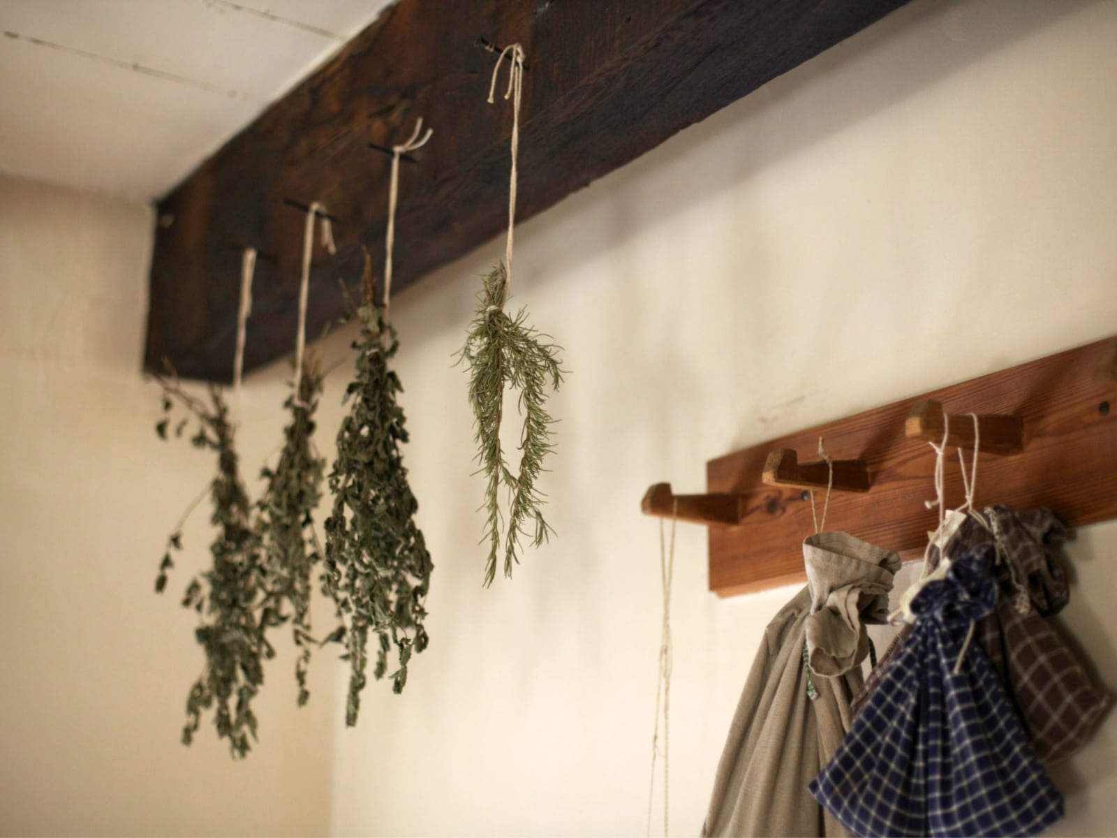 herb bundles hanging from kitchen rafter