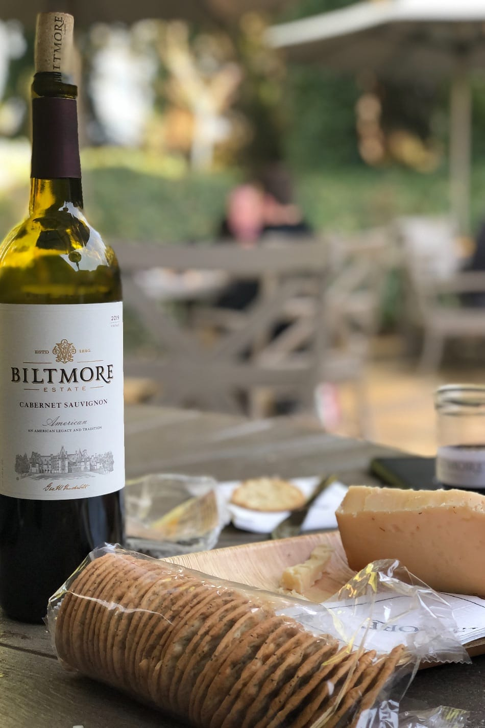 Biltmore wine, cheese, and crackers on table outside