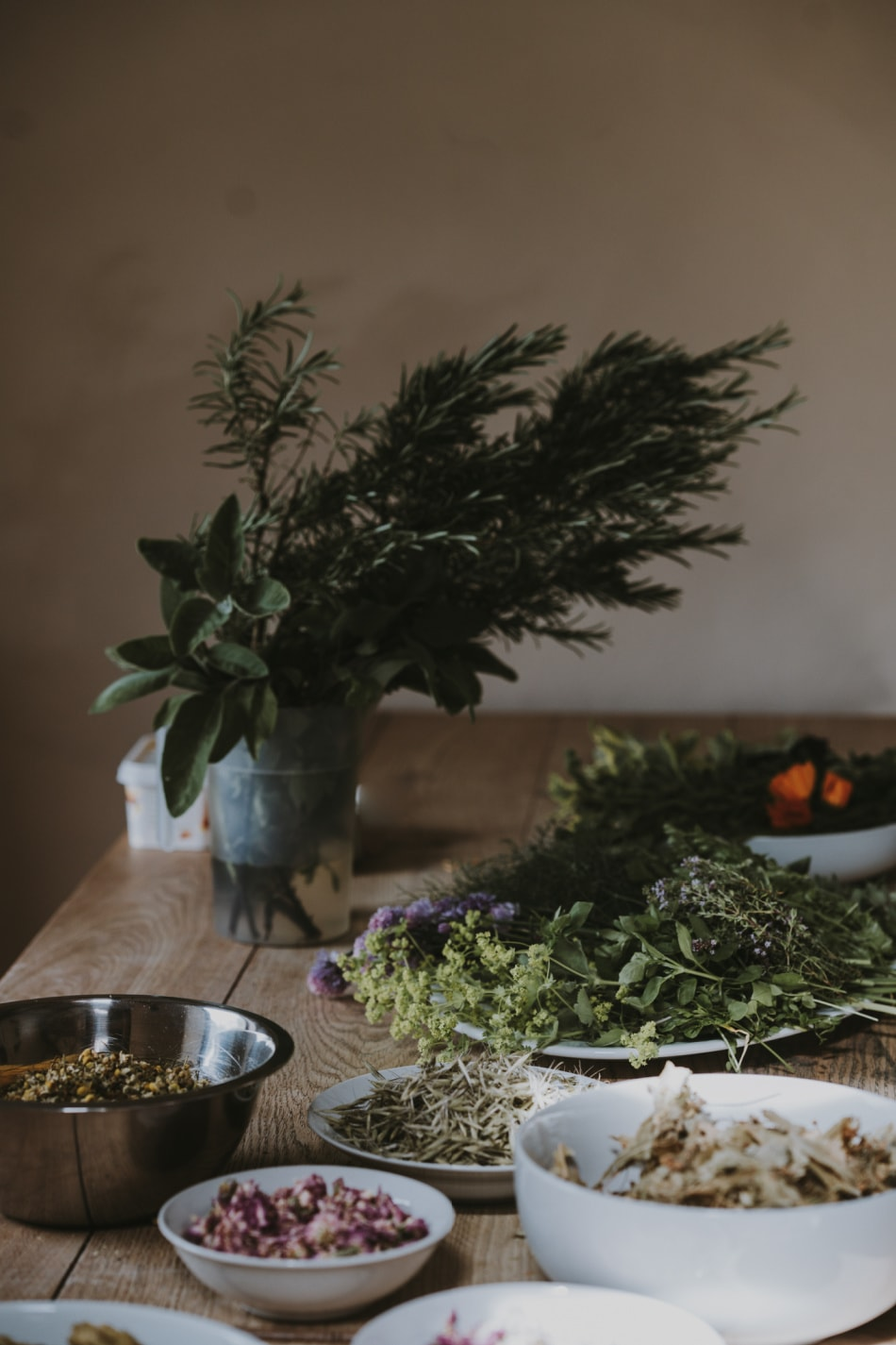 herbs in bowls on table