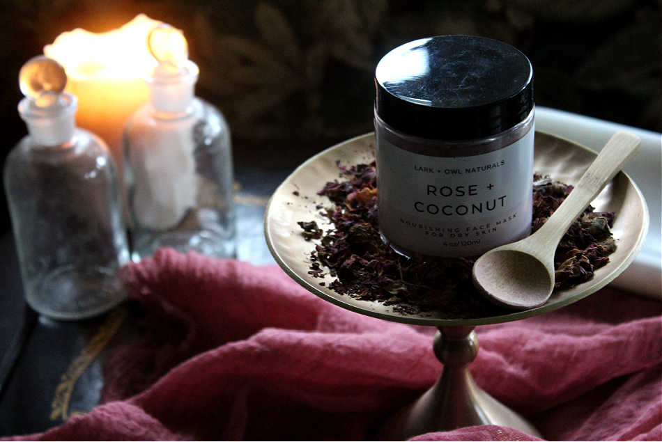 Lark & Owl Naturals Rose + Coconut Face Mask on gold plate with dried rose petals