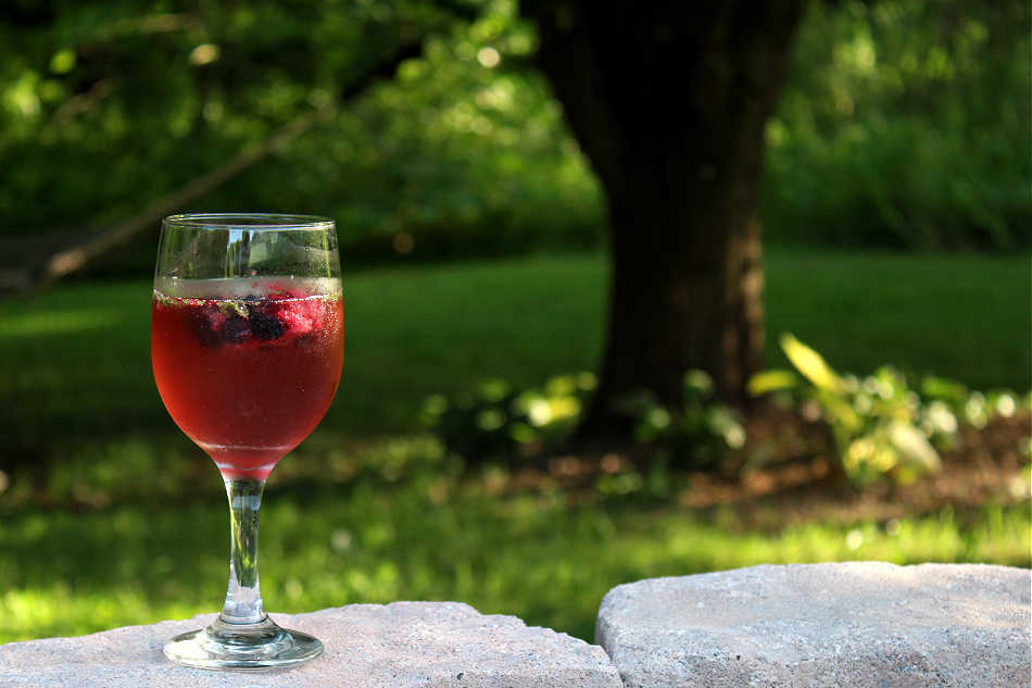 summer mocktail drink sitting on stone wall