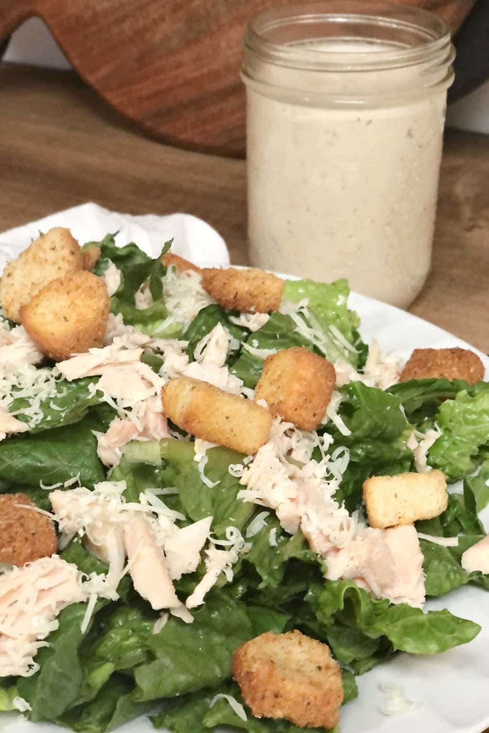 chicken Caesar salad and homemade (anchovy-free) dressing on kitchen counter